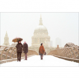 A rectangular Christmas card with a picture of St Paul's Cathedral, taken from Millennium Bridge. It is snowing and the three people visible on the bridge are wrapped up warm.