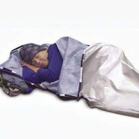 A picture on a white background of a man lying down asleep under a silver survival blanket.